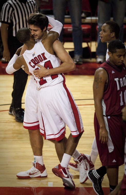 Junior guard Jamal Crook hugs freshman forward Vinny Zollo after Zollo scored while being fouled during the second half of WKUs game against Troy Saturday in Diddle Arena. WKU lost the game 67-65.