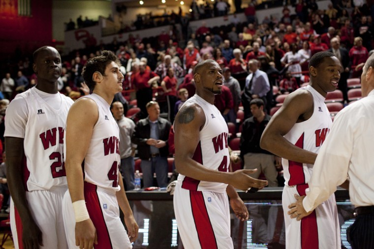 Freshman forward George Fant (center) shows frustration immediately after their overtime loss against Louisiana-Lafayette after realizing that the Ragin Cajuns had six players on the court for a play that resulted in the game-winning basket. WKU lost 72-70.