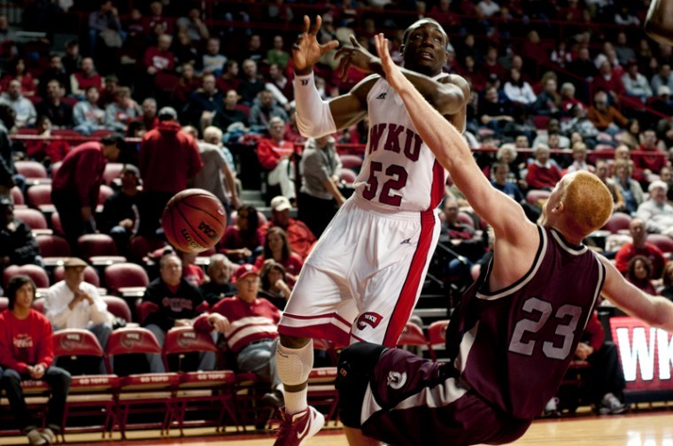 Freshman+guard+T.J.+Price+collides+with+UALR+freshman+forward%0ATaggart+Lockhart+while+attempting+to+make+a+shot+in+the+first+half%0Aof+the+game.+WKU+won+65-53.%0A