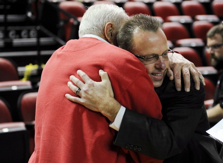 New head coach Ray Harper hugs former head coach John Oldham after a pep rally to announce Harper's hire on Monday in Diddle Arena. After playing for both WKU and the Fort Wayne Pistons of the NBA, Oldham coached the Toppers from 1964 to 1971.