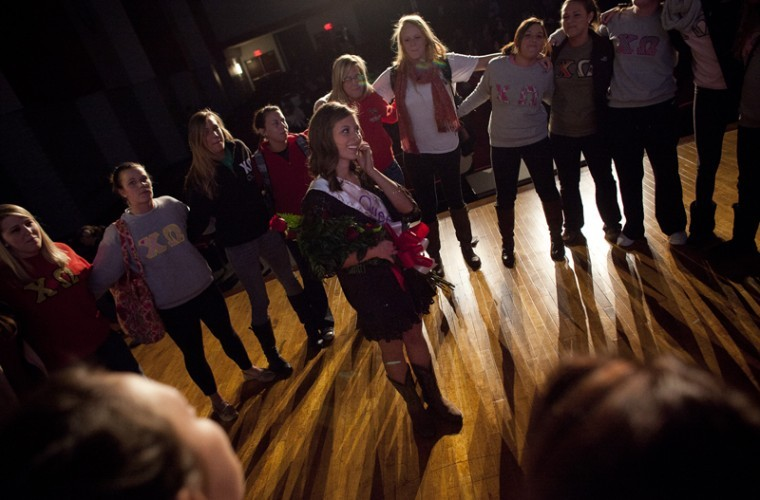 Morgan Threlkeld, a freshman from Madisonville, Ky. is congratulated by other Chi Omega members after being declared the winner at the Contests of Sigma Phi Epsilon Queen of Hearts Beauty Pageant in the DUC auditorium on Feb. 15, 2012.