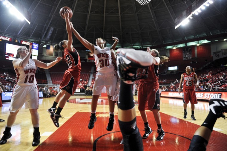 Freshman+forward+Chastity+Gooch+jumps+for+a+rebound+on+Wednesday+against+Arkansas+State+at+Diddle+Arena.+WKU+lost+56-53.%0A