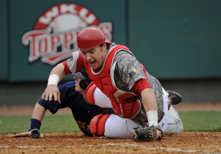 Junior catcher Ryan Huck reacts after tagging out a Toledo player in the first game of a doubleheader Saturday at Nick Denes Field. WKU lost 7-6 but came back to win the final game of the weekend series.