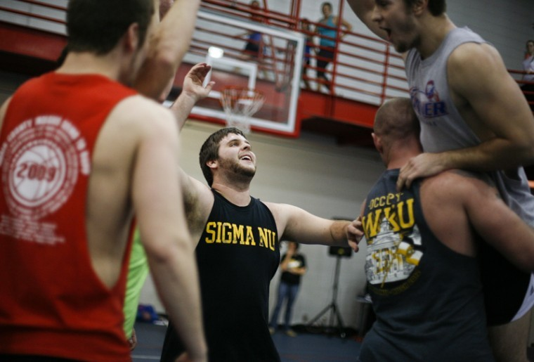 Sigma Nu Wrecking Crew celebrates during their game against Lambda Chi Alpha during WKU's Relay For Life,