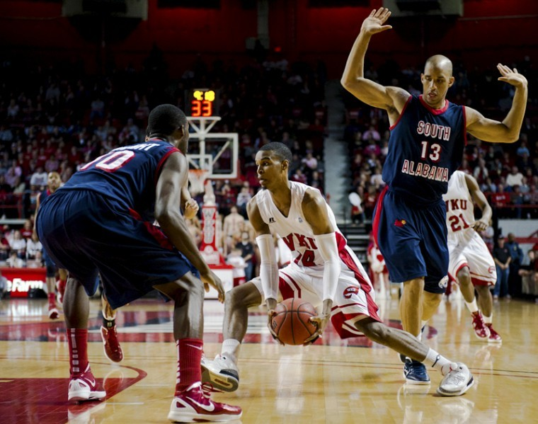 Junior guard Jamal Crook charges to the paint during WKUs game against Southern Alabama at Diddle Arena on Saturday. WKU beat Southern Alabama 75-66. Crook finished with a career-high 24 points and six assists.