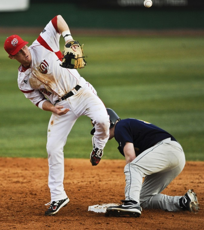 Senior+infielder+Ivan+Hartle+misses+the+ball+during+a+game%0AFriday+against+Toledo+Denes+Field.+WKU+lost+5-2.%0A
