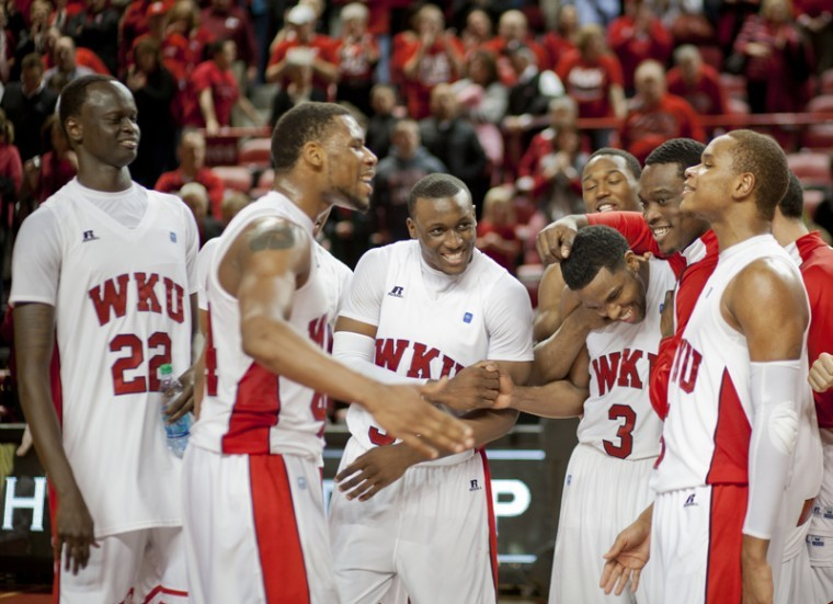 The+WKU+men%27s+basketball+team+celebrates+with+senior+guard+Kahlil+McDonald+%28middle%29+after+McDonald+scored+the+final+basket+of+Saturday%27s+senior+night+game+against+MTSU+at+Diddle+Arena.+WKU+beat+MTSU+73-67+in+front+of+a+sellout+crowd+of+7%2C326.%0A