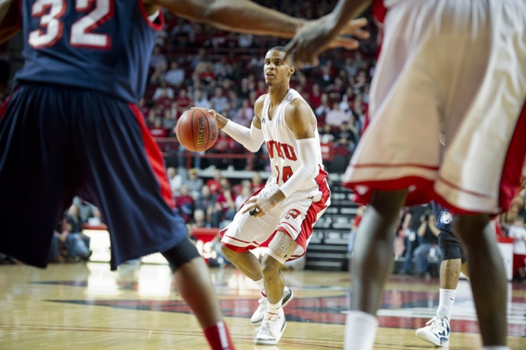 Junior guard Jamal Crook dribbles at the top of the key during WKU's 75-66 win over South Alabama at Diddle Arena Feb. 4. Crook scored 24 points against the Jaguars on 9-of-10 shooting.