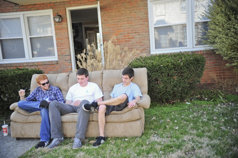 Nashville junior Paul Wilkins and Glasgow juniors Asa Darnell and Kris Simpson enjoy Thursday's spring weather outside Darnell's apartment on Cabell Drive.