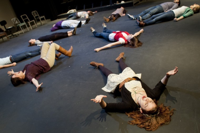 """Louisville junior Kelsey Thompson (bottom right) leads warm-up exercises with cast members during a rehearsal of """"Women and Wallace"""" in the Gordon Wilson Lab Theatre on Wednesday. Performances are on Monday, Feb. 27, and Tuesday, Feb. 28 at 8 p.m. in the Gordon Wilson Lab Theatre."""