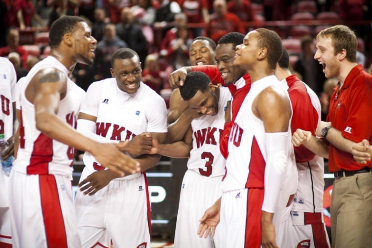 WKU+celebrates+with+senior+guard+Kahlil+McDonald+%28middle%29+at+the+end+of+Saturday%27s+Senior+Night+game+at+Diddle+Arena.+McDonald+scored+the+last+basket+of+the+game+to+help+WKU+edge+out+MTSU%2C+73-67+in+front+of+a+sellout+crowd+of+7%2C326+fans.%0A