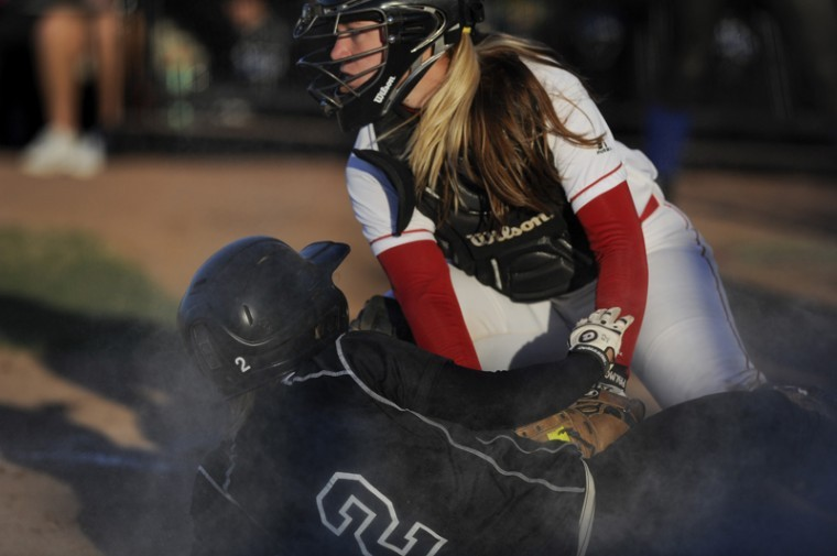 Junior+catcher+Kellie+Quarles+tags+an+Indiana+State+player+during+the+Hilltopper+Spring+Classic+at+the+WKU+Softball+Complex+Sunday+afternoon.+WKU+finished+with+three+wins+this+weekend+including+a+10-2+victory+over+Indiana+State.%0A