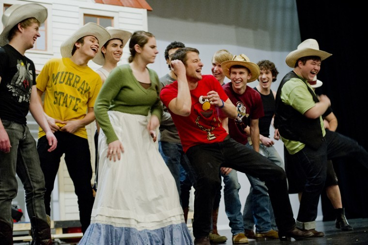 """The cast of """"Oklahoma!"""" performs their first run-through of the entire show at rehearsal Thursday night."""