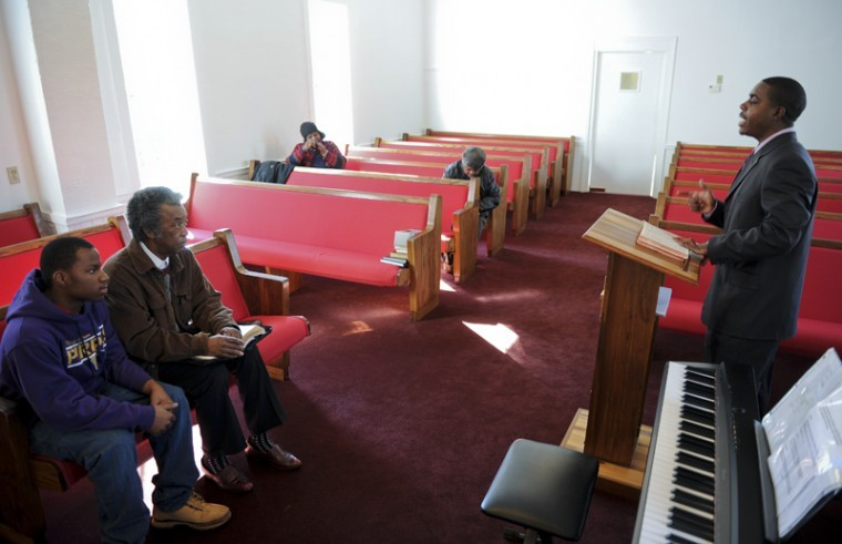 """Bowling Green senior Chad Winston leads a Bible study before preaching at Cedar Grove Baptist Church in Brownsville, which is the only African American church in Edmonson County. Winston was ordained about a year-and-a-half ago. """"I know how it is to be young, and us as young people need more guides than ever,"""" Winston said. """"Tomorrow isn't a promise. I feel why wait till the next day or when I'm older to do a task for God when I can do it now. Never put off or wait to do something because it could be too late."""""""