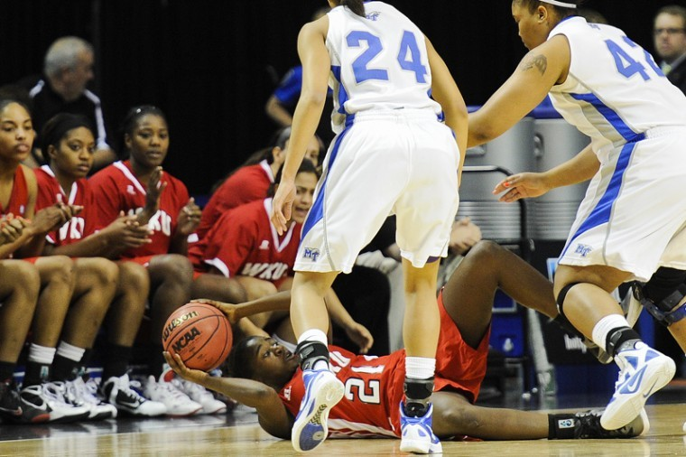 Freshman+guard+Alexis+Govan+looks+for+an+open+pass+during+the+second+round+of+the+Sun+Belt+Conference+Tournament.+The+Lady+Toppers+lost+to+MTSU+65-57.%0A