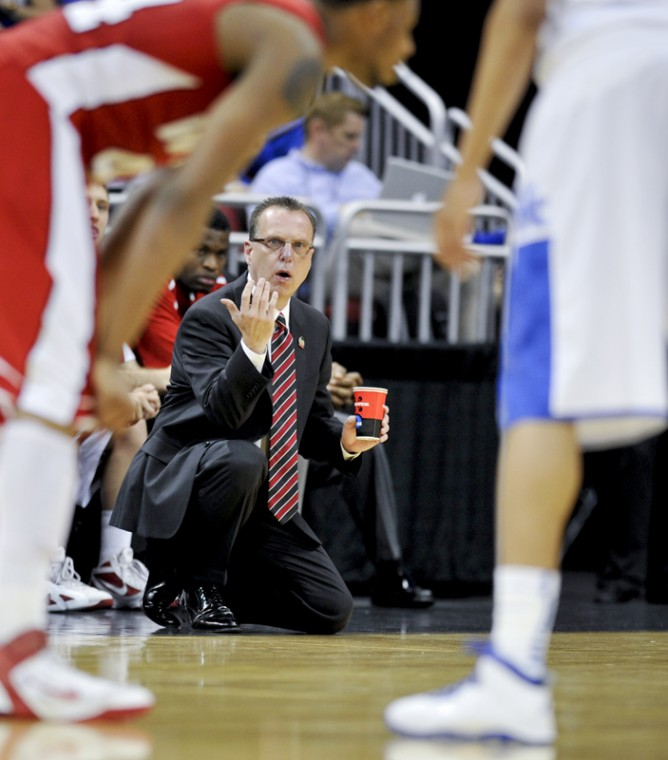 Head+Coach+Ray+Harper+motions+to+his+players+during+the+first+round+NCAA+tournament+game+between+WKU+and+UK+at+the+YUM%21+Center+in+Louisville+Thursday+night.+UK+led+WKU+45-26+at+halftime.%0A