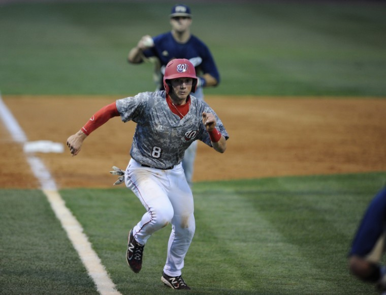 Junior+shortstop+Steve+Hodgins+gets+caught+between+third+base+and+home+while+running+to+home+plate+on+Friday+night+at+Nick+Denes+Field.+WKU+lost+6-5+to+Florida+International.%0A