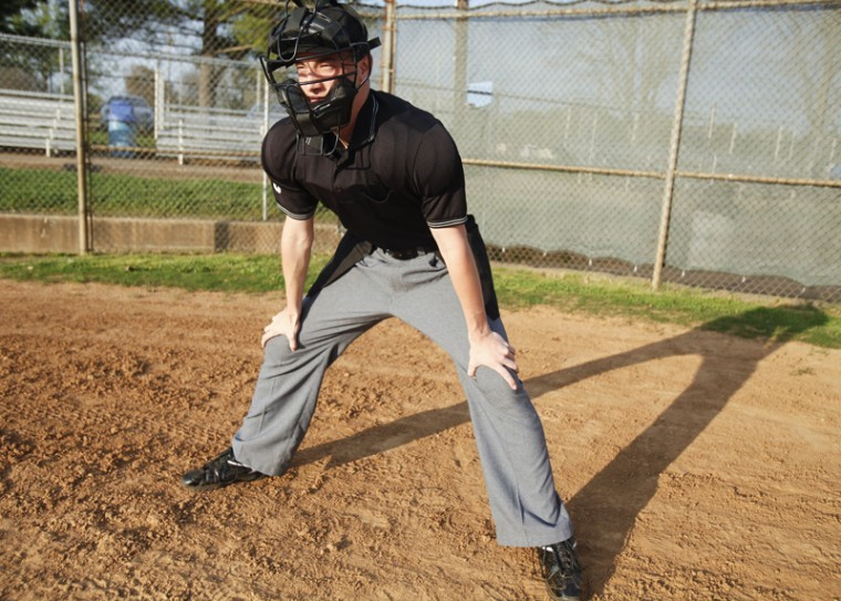 """Bowling Green senior Grant Burkeen has been an umpire since he was 12 years old. His father taught him and his younger sister to be umpires. """"I think it's awesome that I have a job I can go to and love,"""" Burkeen said."""