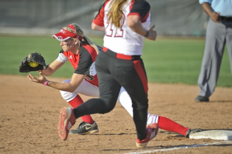 Junior+infielder+Mallorie+Sulaski+makes+an+out+at+first+base+during+the+game+against+Louisville+on+Wednesday+afternoon+at+the+WKU+Softball+Field.+Sulaski+made+10+outs+during+the+game.+WKU+lost+6-0.%0A