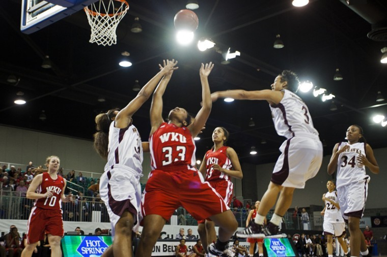Senior guard Vanessa Obafemi fights for the ball during the first round of the Sun Belt Conference Tournament. WKU beat Louisiana-Monroe 66-50.