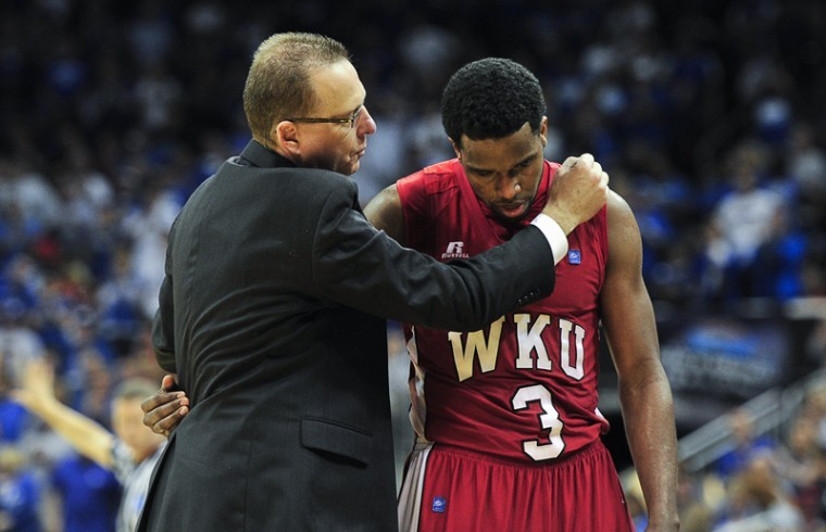 Head+Coach+Ray+Harper+embraces+senior+guard+Kahlil+McDonald+after+UK+beat+WKU+81-66+in+a+second+round+NCAA+tournament+game+at+the+YUM%21+Center+in+Louisville+on+Thursday+night.%0A