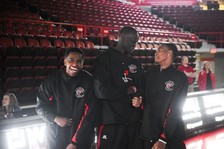 (From left) WKU basketball players Kahlil McDonald, Teeng Akol and Jamal Crook laugh during the viewing party on Selection Sunday. WKU enters as a 16 seed and will play fellow 16 seed Mississippi Valley State on Tuesday in Dayton, Ohio in the First Four. The winner plays No. 1 overall seed Kentucky on Thursday in Louisville.