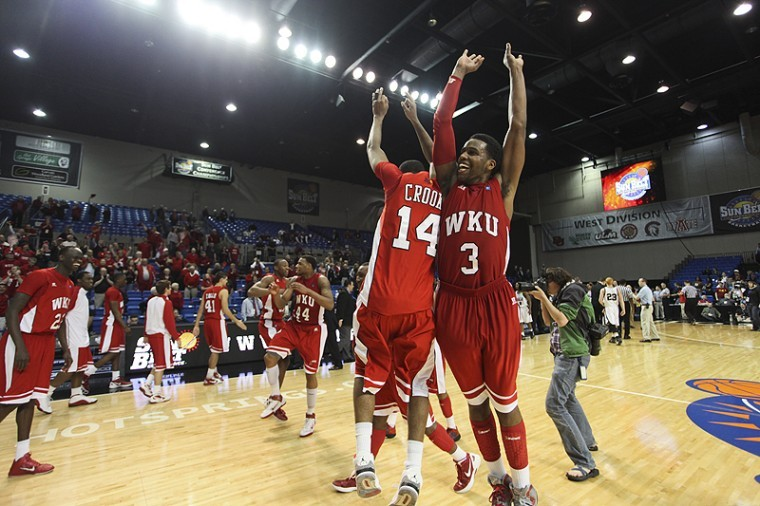 The Toppers celebrate after beating No. 2 seed Arkansas-Little Rock 68-63. WKU moves on to face Denver in the Sun Belt Tournament Semifinals at 8:30 p.m. on Monday.