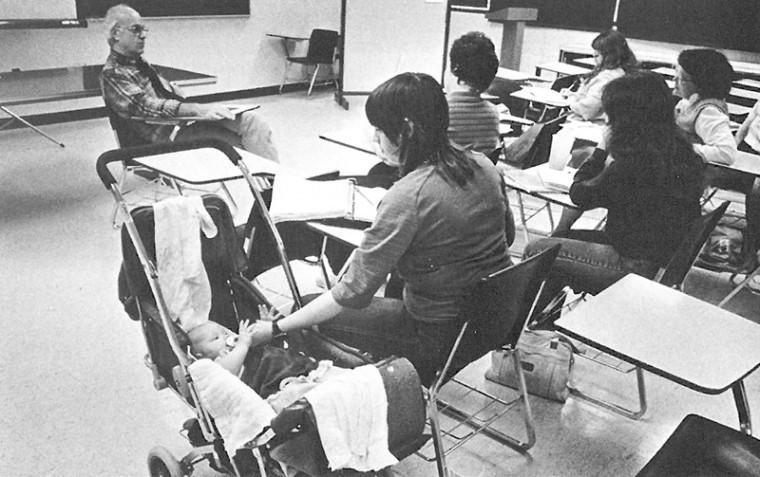 Katie Glynn (now-Pettit) is comforted by her mother, Luanne Glynn, while accompanying her mother to class in 1985.