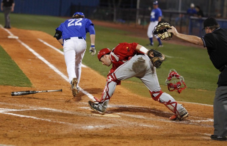 Junior catcher Devin Kelly reaches for a tipped ball at the plate during their game against MTSU Saturday in Murfreesboro, Tenn. The series started conference play for the Toppers in which they lost two of their three games at MTSU.