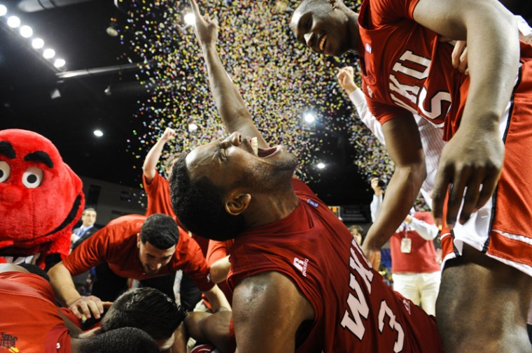 Senior guard Kahlil McDonald celebrates with his teammates after winning the Sun Belt Conference Tournament against North Texas on March 6 in Hot Springs, Ark. WKU defeated North Texas 74-70 to earn an automatic berth in the NCAA Tournament — its first since 2009.