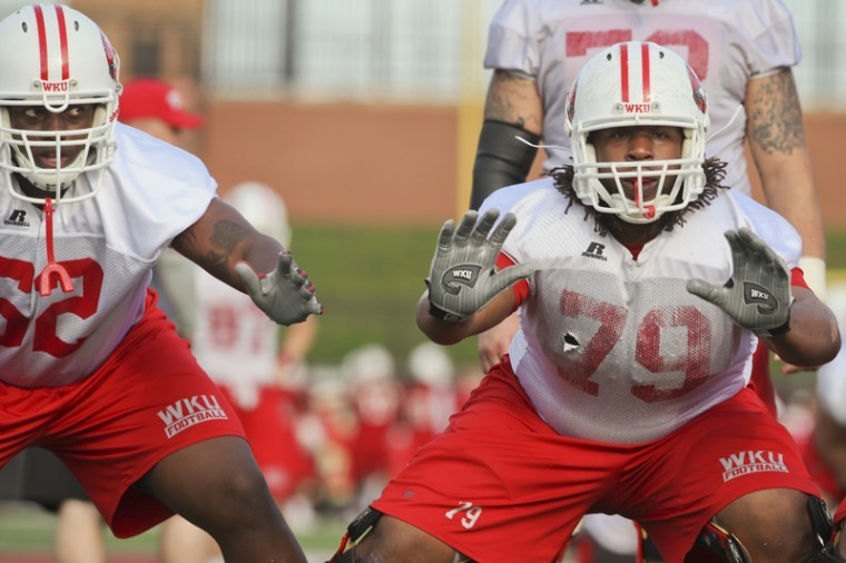 Freshman+offensive+linemen+Delryn+Wilson%2C+right%2C+and+Darrell+Williams+work+on+drills+during+their+first+spring+practice+of+the+2012+season+on+Monday+morning.%0A