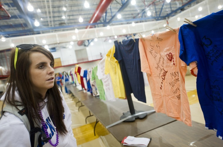 WKU+senior+Rachel+McDivitt+of+Lexington+looks+at+T-shirts+on+display+in+The+Clothesline+Project+during+the+Healthy+Days+event+in+the+Preston+Center+on+Feb.+28.+The+Clothesline+Project+is+put+on+every+year+by+Hope+Harbor%2C+Bowling+Green%27s+rape+crisis+center%2C+as+a+part+of+Sexual+Assault+Awareness+Month.%0A