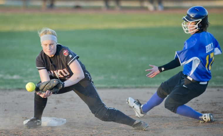 Sophomore shortstop Amanda Thomas attempts to get an out during a game against Morehead State Feb. 25 at the WKU Softball Complex.
