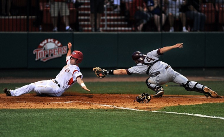 Senior second baseman Ivan Hartle scores WKU's only run during the opening game of its home series against Arkansas-Little Rock on Friday at Nick Denes Field. WKU lost 3-1.