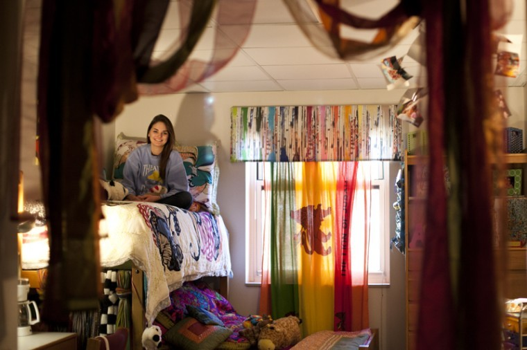 """Murray sophomore Hannah Boone has been living in Meredith Hall for the past two semesters. Boone is a member of the Alpha Omicron Pi Sorority and has turned her typical dorm room into a room of her own. """"I love living with all my best friends,"""" Boone said."""