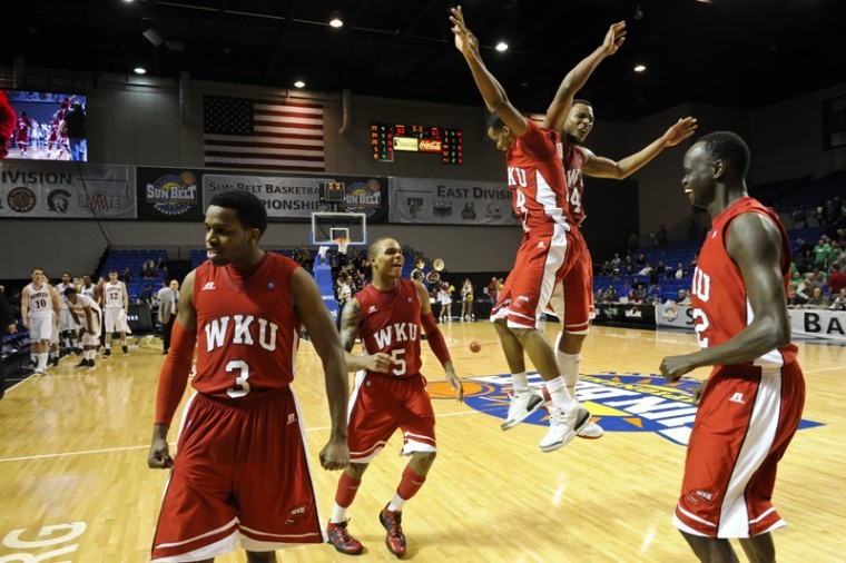 WKU players celebrate their 67-63 win over Denver in the Sun Belt Tournament semifinals on Monday. WKU will play North Texas at 6 p.m. for a chance to earn an automatic bid to the NCAA Tournament. The game will be televised on ESPN2.