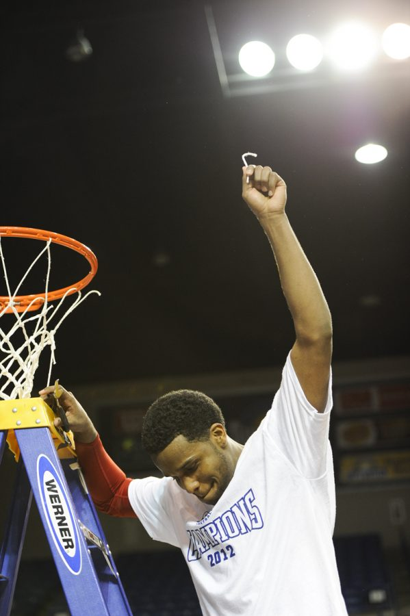 Senior guard Kahlil McDonald holds up his piece of the net after WKU won the Sun Belt Conference Tournament championship. WKU defeated North Texas 74-70 to earn its 22nd appearance in the NCAA Tournament and first since 2009.