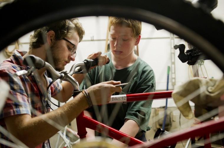 Bowling Green sophomore Joseph Jones and Clarkson freshman Eli Heintzman combine their skills to fix a broken bicycle in WKU's Big Red Bikes shop beneath Parking Structure 1. Jones said he hates the way the bicycles get treated on campus. Many have been abandoned and are later fixed up by mechanics like Jones and Heintzman.