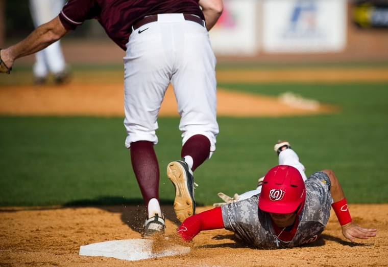 Junior+shortstop+Steve+Hodgins+is+safe+at+first+base+after+a+UALR+pickoff+attempt+during+WKU%27s+5-1+Saturday+win+against+UALR.+The+Toppers+face+UALR+again+at+1+p.m.+on+Sunday.%0A