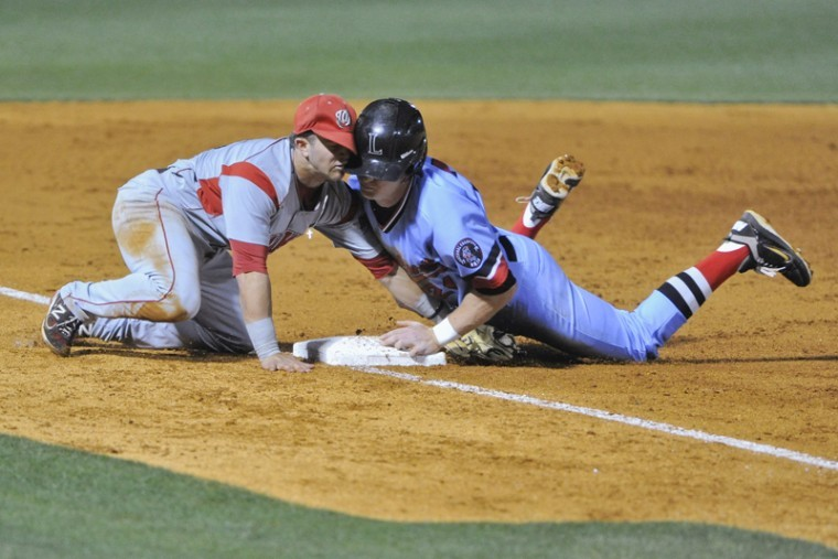 Senior infielder Casey Dykes collides with a Lipscomb runner while tagging him out at third base Wednesday at Dugan Field in Nashville. WKU won 4-3.