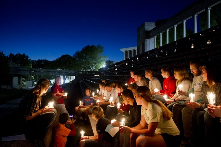 """Students gather at the Colonnade on WKU's campus to participate in the Life Week Prayer Vigil. Mary Reding of the St. Thomas Aquinas Catholic Campus Center said she was happy with the number of students that turned out for the event. """"It takes a lot to get students to come to an event. It is like pulling teeth. But this event was different. People showed up out of the woodwork. It's a really special event,"""" she said."""