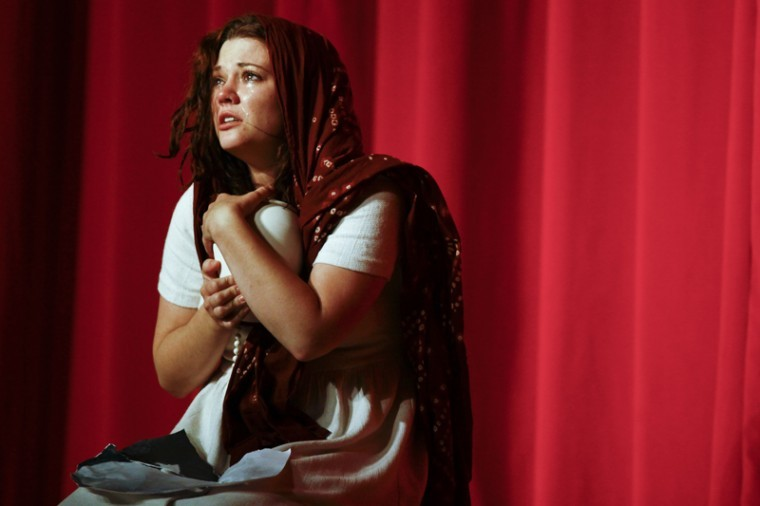 """The wife of Laksmin Srijata, played by Hannah Hardley, cries during a scene of """"A Courtroom Drama of Rebirth"""" Thursday evening in Downing University Center Auditorium."""