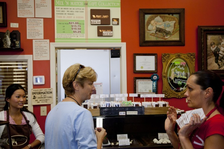 Kay Faesel of Bowling Green, center, shops at Mary Jane's Chocolates Monday afternoon. The store is open from 10 a.m. to 6 p.m. Monday through Friday.