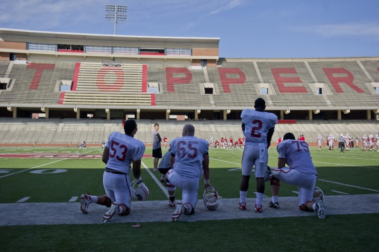 Offensive players take a break during a team scrimmage Saturday at Smith Stadium. WKU's annual spring game will take place at 6 p.m. on Saturday.