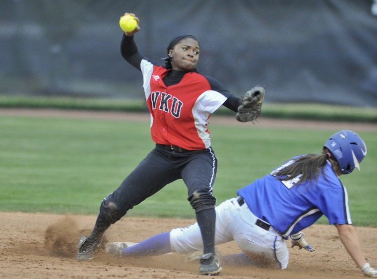 Sophomore infielder Olivia Watkins gets an out at second base and tries to turn a double play against MTSU Wednesday at the WKU Softball Complex. WKU lost 8-4.