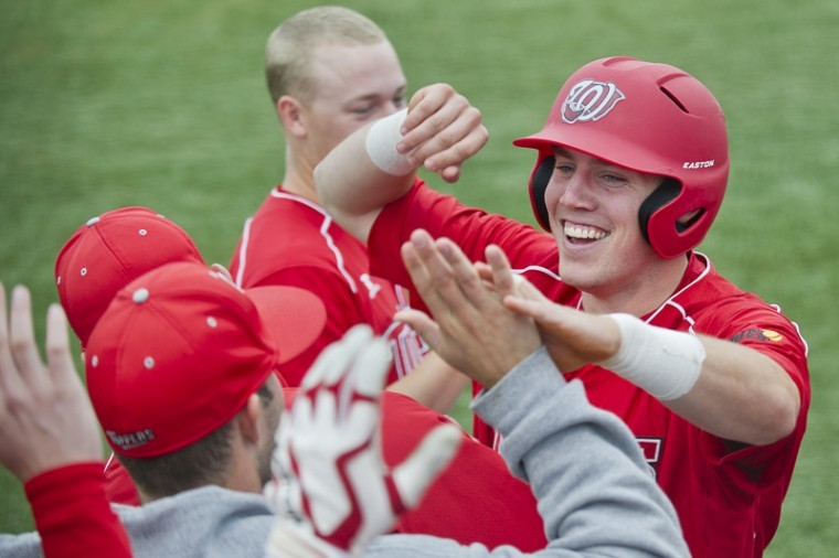 Junior+infielder+Adam+Lavelle+is+congratulated+by+teammates+after+scoring+a+run+against+Troy+at+Nick+Denes+Field+Saturday.+WKU+beat+Troy+9-4.%0A