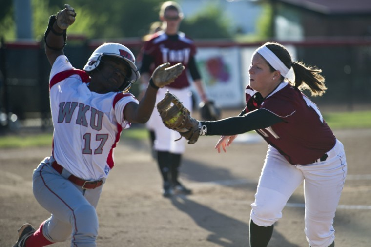 WKU sophomore infielder Olivia Watkins barely misses a tag during the first game against Troy Friday at the WKU Softball Complex. WKU lost 9-1.