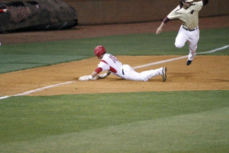 Senior Casey Dykes slides into third base during the WKU vs. Louisiana-Monroe series opener Friday night at Nick Denes Field. The Hilltoppers were defeated 14-6.