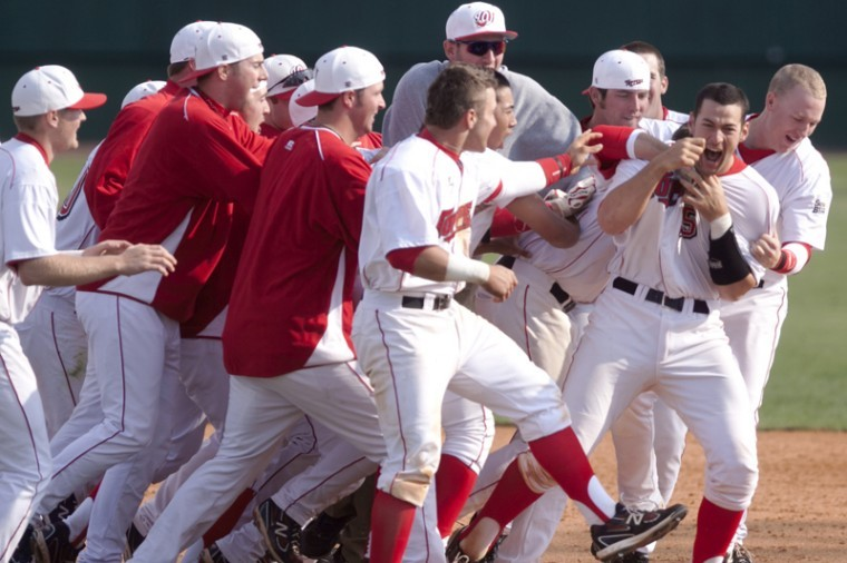 Junior+cathcer+Devin+Kelley+celebrates+with+teammates+after+hitting+a+game-winning+RBI+Sunday+at+Nick+Denes+Field.+WKU+beat+Troy+6-5.%0A