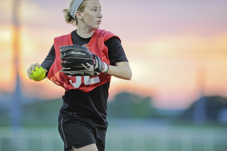A member of I'd Hit That fields the ball during the intramural softball championship game at the Preston Intramural Complex Wednesday. The team won the championship 7-3.